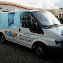 A vehicle decorated with a swimming pool effect print along the side panels