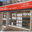 An estate agents external back lit shop front tray sign