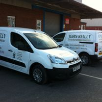 vehicle fleet with corporate details and company decals applied to them