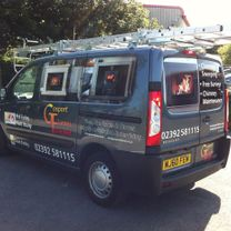 A fireplace specialists vehicle decorated inprinted vinyl graphics in the panels and company logo and contact information on the sides and rear