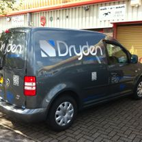 Vehicle graphics with rear window vinyl matching paint colour with company logo and details applied to it