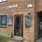 laser cut logo, raised off sign, window manifestaion and tray sign with removeable plaques of practicioners on an exterior wall of a dental surgery