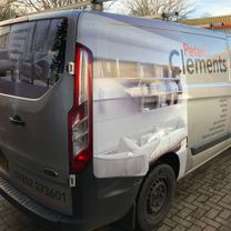 A tradesman van decorated in 1/4 wrap with company details applied to it