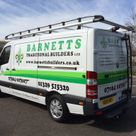 a business van decorated with company logo and contact details