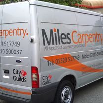 A tradesmans vehicle vinyl decorated with company name and contact details, and with a bespoke decorative swoosh design down the sides