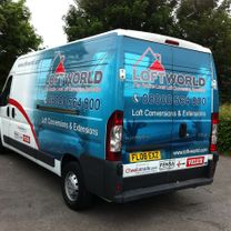 A tradesmans company vehicle with a 1/2 decorative image wrap complete with company contact details