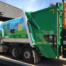 A council recycling dust cart with a colourful graphic wrap applied to it