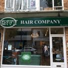 A hair dressers external shop sign tray with raised off logo